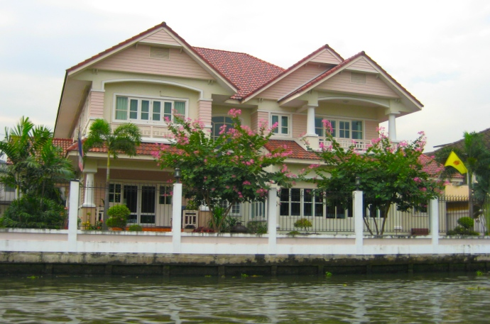 a modern looking house along the canal