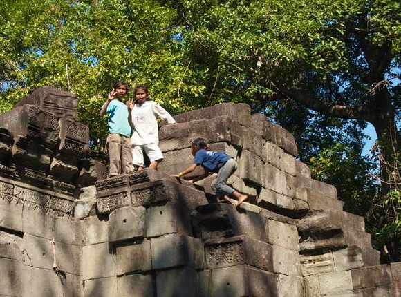 Children scramble around on the ruins of Beng Mealea