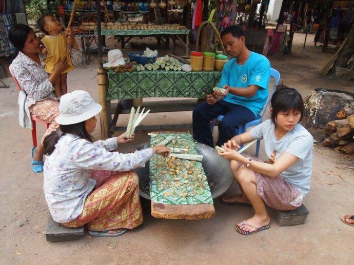 A family prepares sugar cane