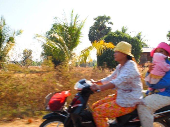 Cambodians on bikes