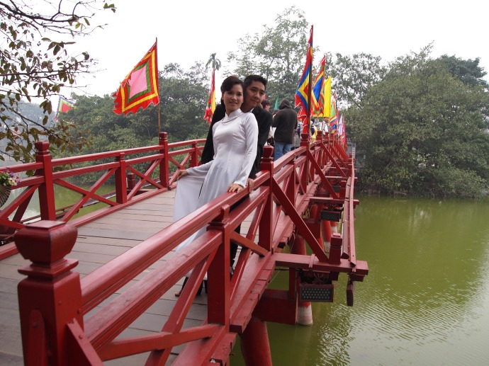 a young vietnamese couple on the bridge at hoan kiem lake