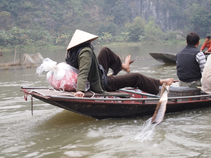 the vietnamese are adept at paddling with their feet:-)