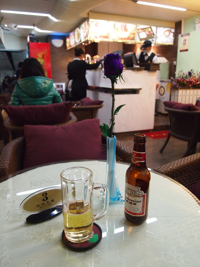 my lone beer at the guangzhou airport... trying to pass the time