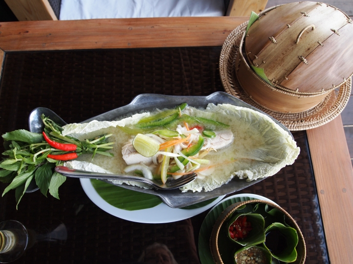 lunch of steamed fish with lime juice & leaf bowls of sauces