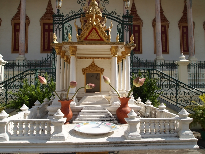 a mini shrine in front of the silver pagoda