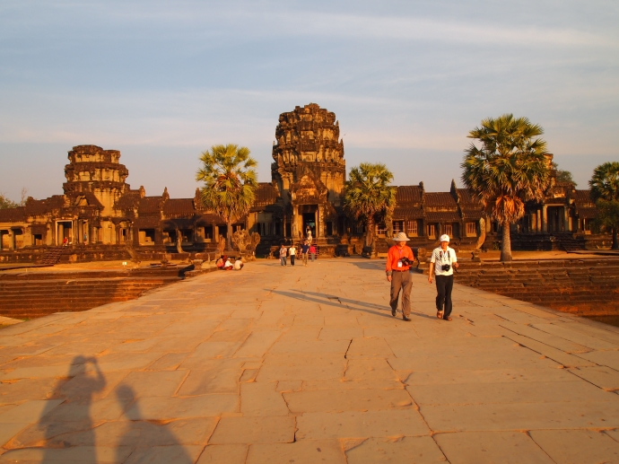 walking across the moat to the outer gate of angkor wat