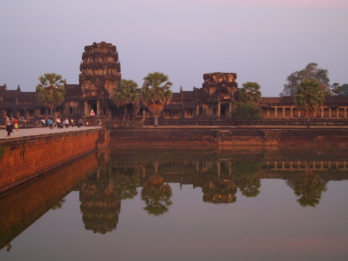 the outer wall of angkor wat reflected in the moat