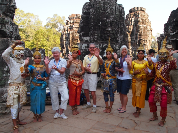 at the bayon with cambodians in traditional costume