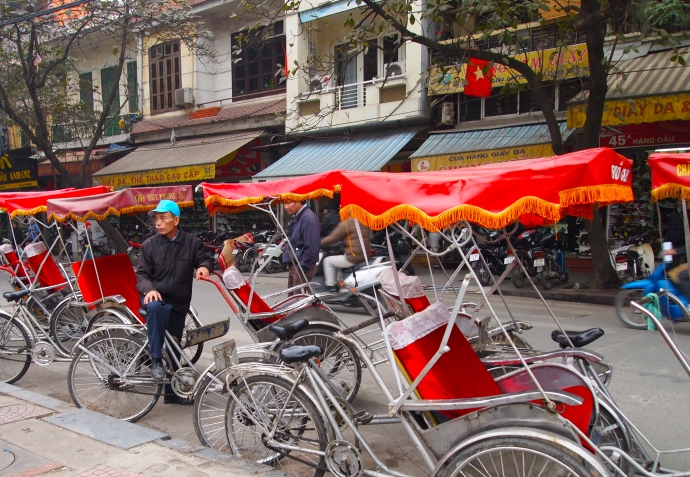 rickshaws outside of Hoan Kiem Lake
