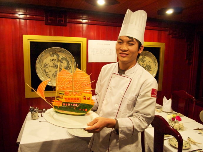 the chef with his sailing ship carved out of watermelon