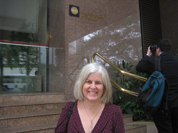 me in front of the Monetary Authority of Singapore