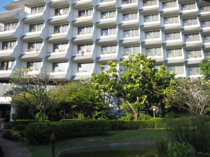 the other high rise rooms in the hotel, surrounding the cottages