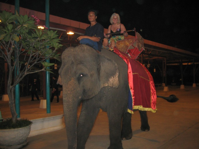 riding an elephant in NOT-ideal surroundings