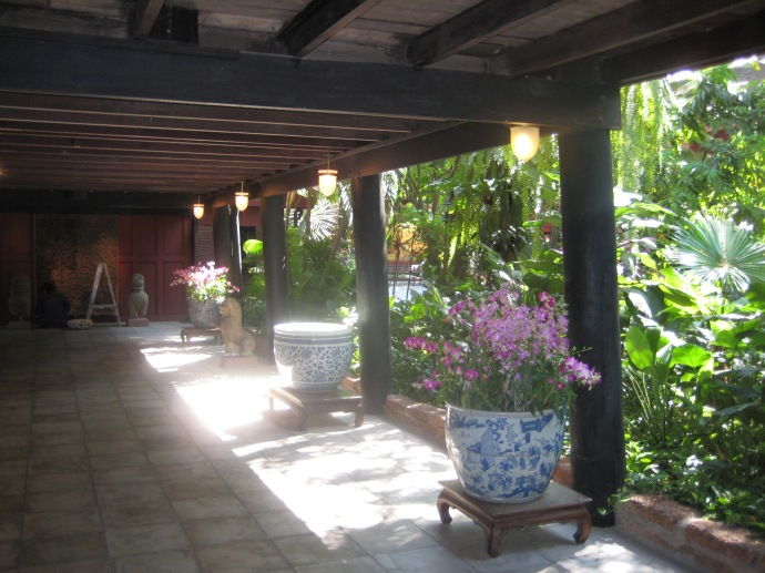 on the porch at Jim Thompson House, looking out at the gardens