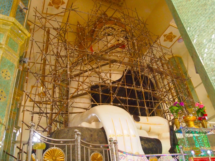 Buddha under repair at Taung Min Gyi Pagoda