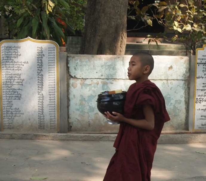 a straggler monk heading to lunch