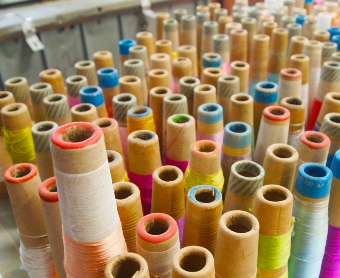 Spools of thread at the Thein Nyo Silk Weaving Factory