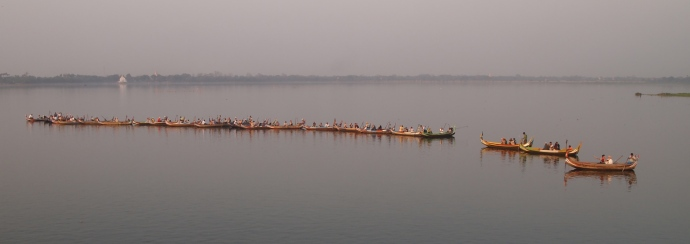 Boats lined up to view the sunset at U Bein Bridge