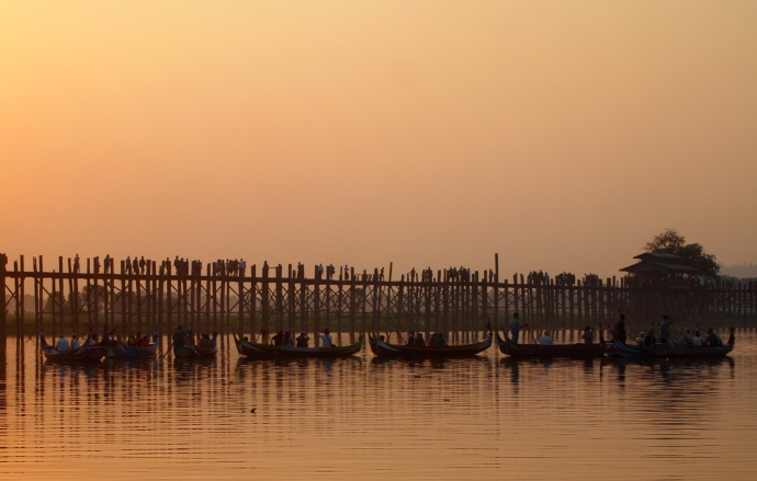 Boats and U Bein Bridge at sunset