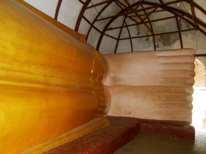 a reclining Buddha's feet at Manuha Paya