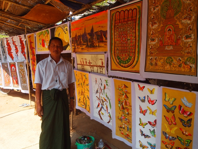 artist with sand paintings