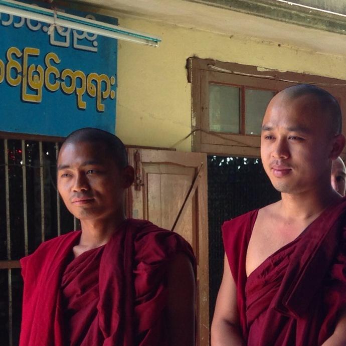 monks at the summit of Thaung Kalat
