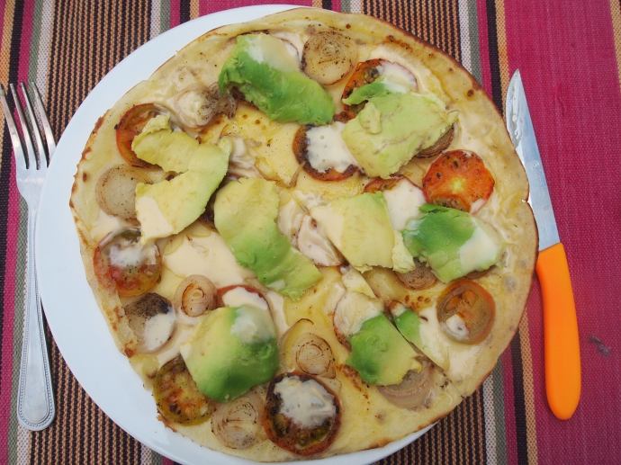 pancake with tomato, onion, cheese and avocado