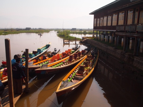 long-tail boats at the monastery