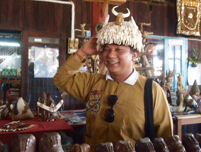 a tourist tries on a hat