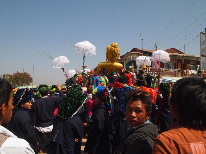 the crowds carry the Buddha