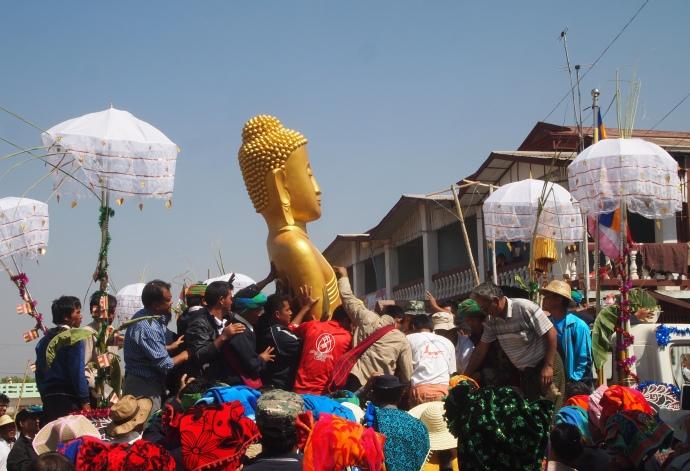 the Buddha being raised