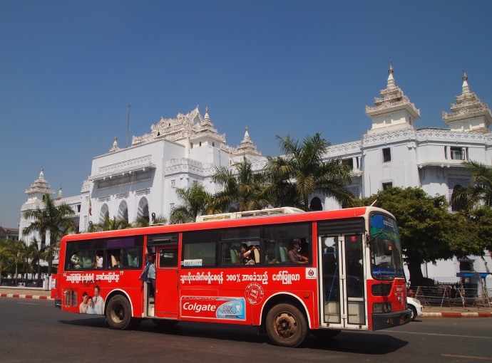 a bus goes by Yangon's City Hall