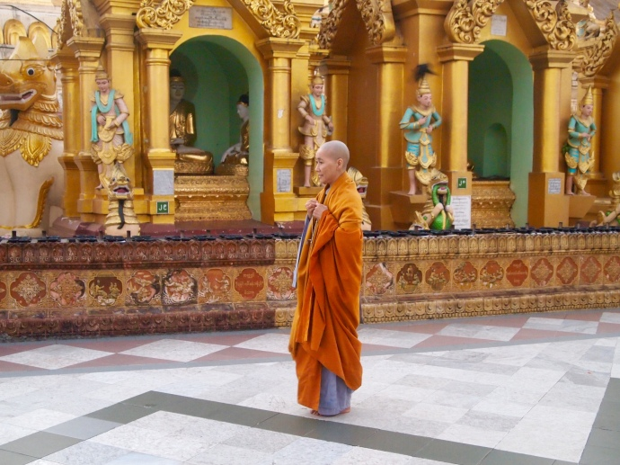 a monk walks clockwise around the pagoda
